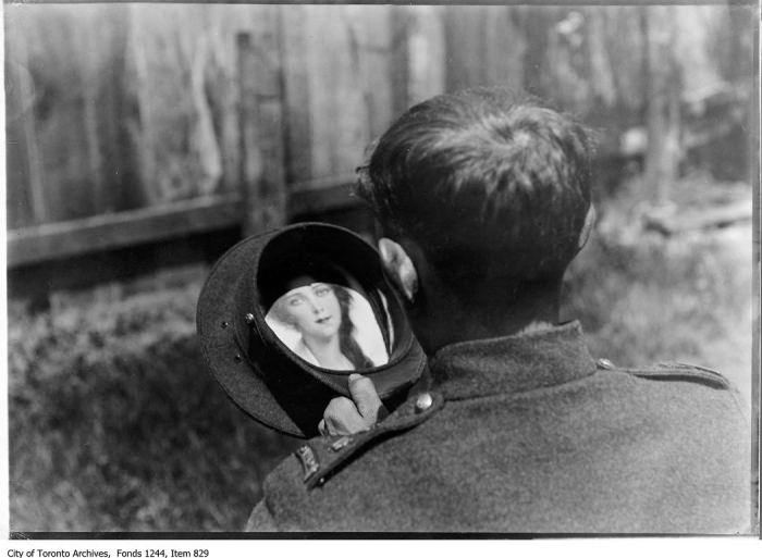 Soldier with woman's picture in hat. - 1916