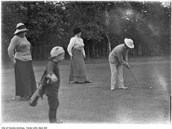 Golfers and caddy. - 1907