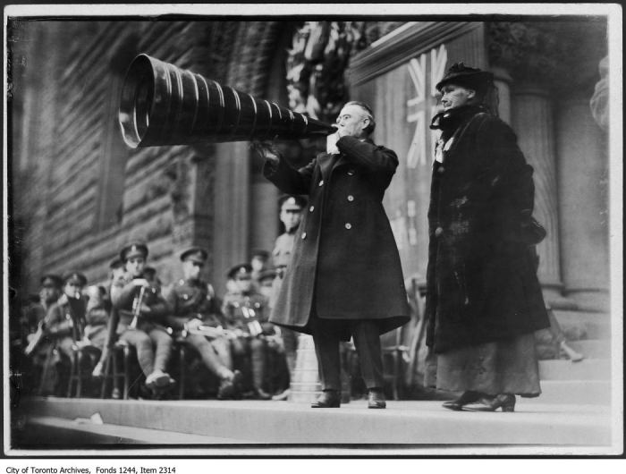 Speaker uses megaphone, City Hall. - 1916