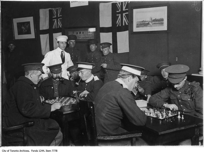 Soldiers playing chess and checkers, CNE camp. - [ca. 1915]