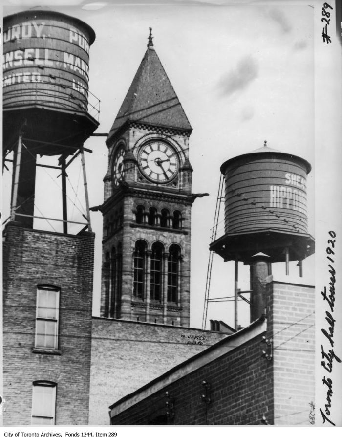 Water tanks and City Hall clocktower. - 1920