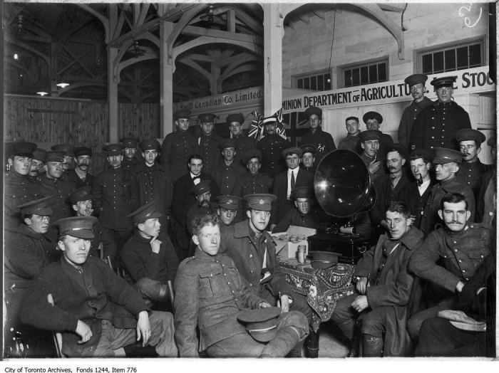 Soldiers around phonograph, Livestock Building, CNE military training camp. - [ca. 1914]