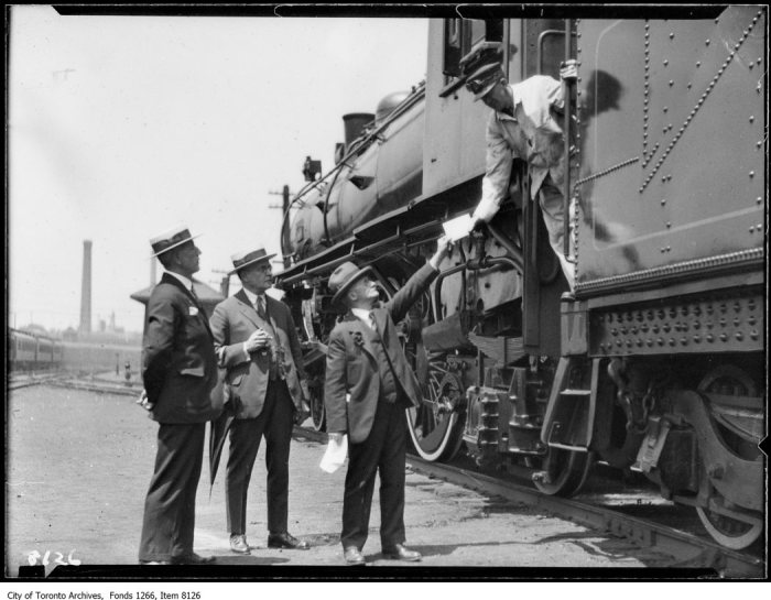 C.P.R. new Montreal train, officials & engineer, handing letter. - June 28, 1926